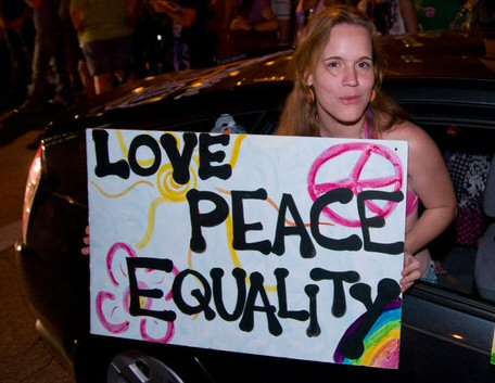 Love Peace Equality Sign at Gay Pride Parade - Statesman
